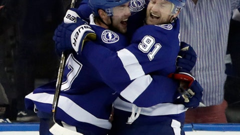 Tampa Bay Lightning defenseman Victor Hedman (77) and center Steven Stamkos (91) celebrate after Hedman scored against the Philadelphia Flyers during the third period of an NHL hockey game Saturday, March 3, 2018, in Tampa, Fla. The Lightning won the game 7-6 in a shootout. (AP Photo/Chris O'Meara)