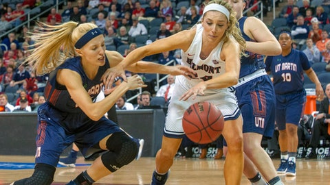 Belmont's Jenny Roy (24) fights for the ball with UT Martin's Maddie Waldrop, left, during the first half of an NCAA college basketball game in the championship of the Ohio Valley Conference tournament, Saturday, March 3, 2018, in Evansville, Ind. (AP Photo/Daniel R. Patmore)