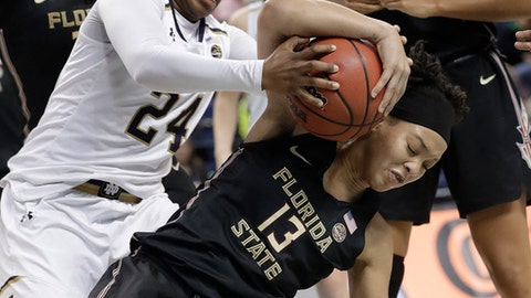 Notre Dame's Arike Ogunbowale (24) and Florida State's Nausia Woolfolk (13) battle for a rebound during the second half of an NCAA college basketball game in the semifinals of the women's Atlantic Coast Conference tournament in Greensboro, N.C., Saturday, March 3, 2018. Notre Dame won 90-80. (AP Photo/Chuck Burton)