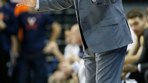 Notre Dame head coach Mike Brey directs his team against Virginia during the first half of an NCAA college basketball game in Charlottesville, Va., Saturday, March 3, 2018. (AP Photo/Steve Helber)
