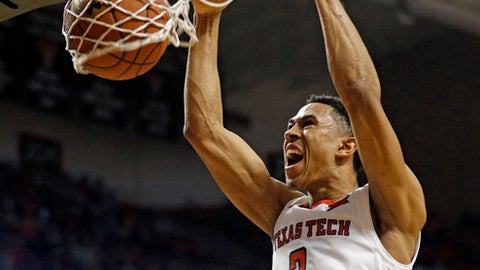 Texas Tech's Zhaire Smith (2) dunks the ball during the first half of an NCAA college basketball game against TCU, Saturday, March 3, 2018 in Lubbock, Texas. (AP Photo/Brad Tollefson)