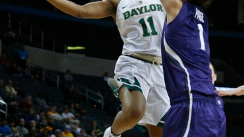 Baylor guard Alexis Morris (11) goes up for a shot in front of Kansas State forward Kaylee Page (1) in the first half of an NCAA college basketball game in the quarterfinals of the women's Big 12 conference tournament in Oklahoma City, Saturday, March 3, 2018. (AP Photo/Sue Ogrocki)