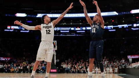 Penn State forward Lamar Stevens (11) puts up a shot against Purdue forward Vincent Edwards (12) during the first half of an NCAA Big Ten Conference tournament semifinal college basketball game, Saturday, March 3, 2018, in New York. (AP Photo/Julie Jacobson)