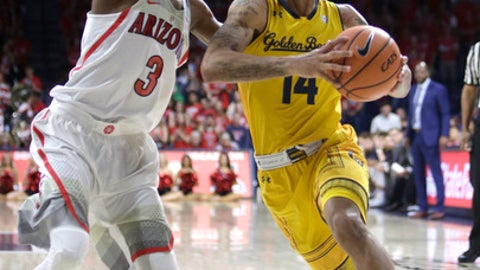 California guard Don Coleman (14) drives on Arizona guard Dylan Smith during the first half of an NCAA college basketball game Saturday, March 3, 2018, in Tucson, Ariz. (AP Photo/Rick Scuteri)