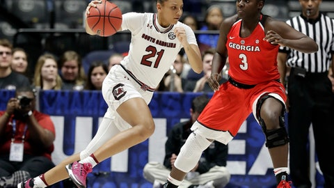 South Carolina's Mikiah Herbert Harrigan (21) drives against Georgia's Stephanie Paul (3) in the first half of an NCAA college basketball semifinal game at the women's Southeastern Conference tournament, Saturday, March 3, 2018, in Nashville, Tenn. (AP Photo/Mark Humphrey)