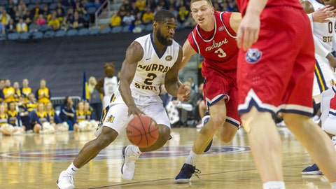 Murray State's Jonathan Stark (2) drives the ball toward Belmont's Dylan Windler (3) during the first half of an NCAA college basketball game in the championship of the Ohio Valley Conference tournament, Saturday, March 3, 2018, in Evansville, Ind. (AP Photo/Daniel R. Patmore)