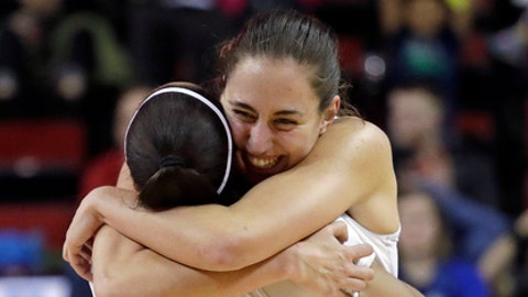 Oregon's Maite Cazorla is embraced by Justine Hall (3) after the team defeated UCLA 65-62 in an NCAA college basketball game in the semifinals of the Pac-12 women's tournament, Saturday, March 3, 2018, in Seattle. (AP Photo/Elaine Thompson)
