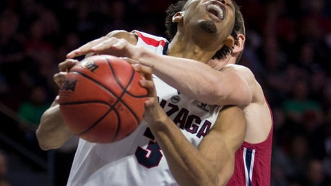 Gonzaga's Johnathan Williams (3) is fouled from behind by Loyola Marymount's Mattias Markusson during the second half of an NCAA college basketball game in the quarterfinals of the West Coast Conference men's tournament Saturday, March 3, 2018, in Las Vegas. (AP Photo/L.E. Baskow)