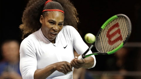 FILE - In this Feb. 11, 2018, file photo, United States' Serena Williams returns a shot against the Netherlands during a doubles match in the first round of Fed Cup tennis competition in Asheville, N.C. Tennis great Chris Evert expects new mom Serena Williams will eclipse the Grand Slam record of 24 singles titles, maybe even this season.  (AP Photo/Chuck Burton, File)