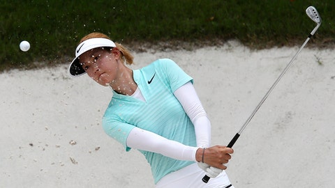 Michelle Wie of the United States hits out of the sand trap on the 17th hole during the first round of the Sime Darby LPGA golf tournament at Tournament Players Club (TPC) in Kuala Lumpur, Malaysia, Thursday, Oct. 26, 2017. (AP Photo/Sadiq Asyraf)