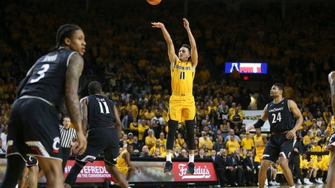 Wichita State guard Landry Shamet hits a three-pointer against Cincinnati during the first half of a college basketball game on Sunday, March 4, 2018 in Wichita, Kan. (Travis Heying/The Wichita Eagle via AP)