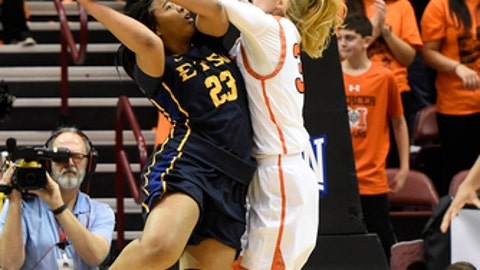 Mercer center Rachel Selph (34) blocks the shot of East Tennessee State forward Britney Snowden (23 ) in the first half of an NCAA college basketball game in the Southern Conference tournament championship on Sunday, March 4, 2018, in Asheville, N.C. (AP Photo/Kathy Kmonicek)