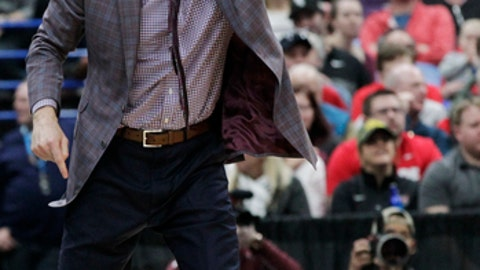 Loyola head coach Porter Moser shouts directions to his players during the first half of an NCAA college basketball game against Illinois State in the championship of the Missouri Valley Conference tournament, Sunday, March 4, 2018, in St. Louis. (AP Photo/Tom Gannam)
