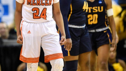 Mercer guard Kahlia Lawrence (24) celebrates after winning control of the ball as East Tennessee State guard/forward Shy Copney (44) and guard Erica Haynes-Overton (20) react in the second half of an NCAA college basketball game in the Southern Conference tournament championship on Sunday, March 4, 2018, in Asheville, N.C. (AP Photo/Kathy Kmonicek)