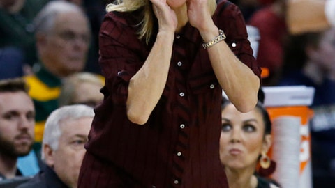 Baylor head coach Kim Mulkey shouts to her team in the first half of an NCAA college basketball game against TCU in the semifinals of the women's Big 12 conference tournament in Oklahoma City, Sunday, March 4, 2018. (AP Photo/Sue Ogrocki)
