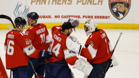 Florida Panthers players congratulate each other after they defeated the Philadelphia Flyers in an NHL hockey game, Sunday, March 4, 2018, in Sunrise, Fla. From left to right, are: Aleksander Barkov, Jonathan Huberdeau, James Reimer and Roberto Luongo. (AP Photo/Wilfredo Lee)