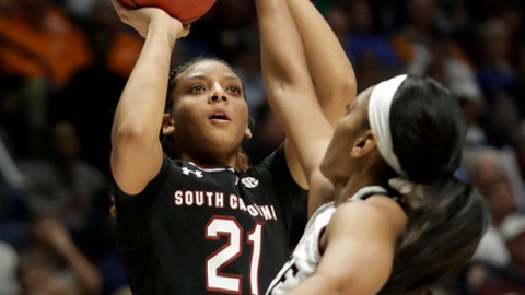 South Carolina's Mikiah Herbert Harrigan (21) shoots over the reach of Mississippi State's Victoria Vivians in the first half of the NCAA college basketball championship game at the women's Southeastern Conference tournament, Sunday, March 4, 2018, in Nashville, Tenn. (AP Photo/Mark Humphrey)