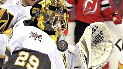 Vegas Golden Knights goaltender Marc-Andre Fleury (29) stops the puck during the second period of an NHL hockey game against the New Jersey Devils, Sunday, March 4, 2018, in Newark, N.J. (AP Photo/Bill Kostroun)