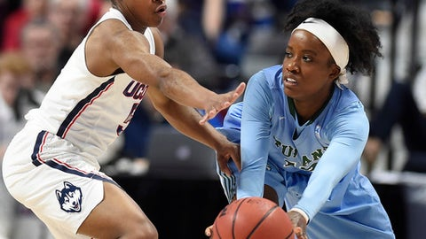 Connecticut's Crystal Dangerfield, left, guards Tulane's CaylahCruickshank, right, during the first half of an NCAA college basketball game in the American Athletic Conference tournament quarterfinals at Mohegan Sun Arena, Sunday, March 4, 2018, in Uncasville, Conn. (AP Photo/Jessica Hill)