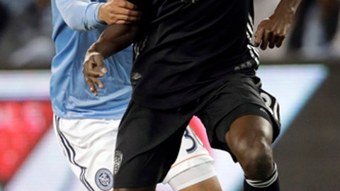 New York City defender Anton Tinnerholm, back, hangs on to Sporting Kansas City defender Ike Opara during the first half of an MLS soccer match in Kansas City, Kan., Sunday, March 4, 2018. (AP Photo/Orlin Wagner)