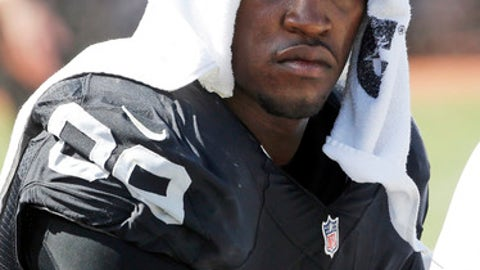 FILE - In this Sunday, Sept. 20, 2015 file photo, Oakland Raiders defensive end Aldon Smith (99) cools off during an NFL football game against the Baltimore Ravens in Oakland, Calif. Oakland Raiders linebacker Aldon Smith was suspended Tuesday, Nov. 17, 2015 by the NFL for one calendar year because of violations of the league's substance-abuse policy, a person with direct knowledge of the decision said.(AP Photo/Tony Avelar, File)