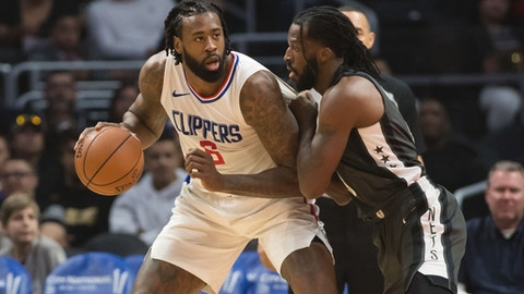 LOS ANGELES, CA - MARCH 04: Los Angeles Clippers Center DeAndre Jordan (6) drives the ball into the basket against Brooklyn Nets Forward DeMarre Carroll (9) during the game between the Brooklyn Nets and the L.A. Clippers on March 04, 2018, at STAPLES Center in Los Angeles, CA. (Photo by David Dennis/Icon Sportswire via Getty Images)
