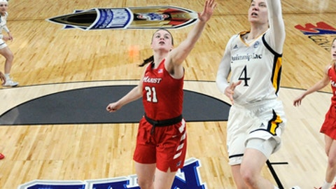 Quinnipiac forward Paula Strautmane (4) scores in front of Marist forward Willow Duffell (21) during the second half of an NCAA college basketball game in the championship of the Metro Atlantic Athletic Conference tournament Monday, March 5, 2018, in Albany, N.Y. (AP Photo/Hans Pennink)