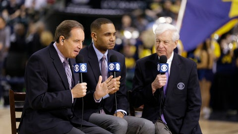 CBS broadcasters, left to right, play-by-play commentator Jim Nantz, along with game analyses Grant Hill and Bill Raftery work before NCAA college basketball game during the semifinals of the Big Ten Conference tournament in Indianapolis, Saturday, March 12, 2016. (AP Photo/Michael Conroy)