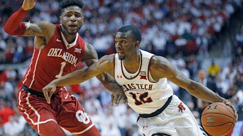FILE - In this Feb. 13, 2018, file photo, Texas Tech's Keenan Evans (12) lays up the ball around Oklahoma's Christian James (1) during an NCAA college basketball game, in Lubbock, Texas. Evans was named to the AP All-Big 12 team, Tuesday, March 6, 2018. (AP Photo/Brad Tollefson, File)