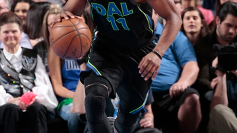 DALLAS, TX - MARCH 6: Yogi Ferrell #11 of the Dallas Mavericks handles the ball during the game against the Denver Nuggets on March 6, 2018 at the American Airlines Center in Dallas, Texas. (Photo by Glenn James/NBAE via Getty Images)