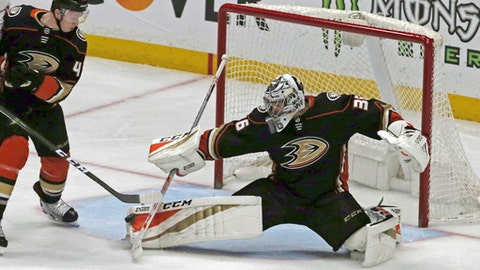 Anaheim Ducks goalie John Gibson (36) blocks a shot by the Washington Capitals during the second period of an NHL hockey game in Anaheim, Calif., Tuesday, March 6, 2018. (AP Photo/Reed Saxon)