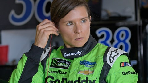 FILE - This Feb. 17, 2018 file photo shows Danica Patrick preparing for practice for the NASCAR Daytona 500 Cup Series auto race at Daytona International Speedway in Daytona Beach, Fla. Patrick is ready for the final leg of her Danica Double and will get fitted for her Indianapolis 500 seat next week. She will drive in the May race for Ed Carpenter Racing. Her first time back in an Indy car will be at the end of this month during a test session for Chevrolet at Indianapolis 500. Patrick shunned the superstitious avoidance of the number 13 and will drive it at Indy for Carpenter. (AP Photo/Phelan M. Ebenhack, file)