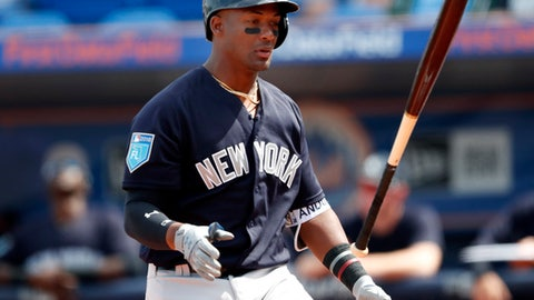 New York Yankees' Miguel Andujar (67) flips his bat after a swinging and missing a pitch in the first inning of a spring training baseball game against the New York Mets, Wednesday, March 7, 2018, in Port St. Lucie, Fla.. (AP Photo/John Bazemore)