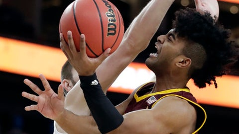 Arizona State's Remy Martin, right, shoots while defended by Colorado's Lucas Siewert, left, during the first half of an NCAA college basketball game in the first round of the Pac-12 men's tournament Wednesday, March 7, 2018, in Las Vegas. (AP Photo/Isaac Brekken)