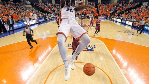 Bucknell's Nana Foulland (20) dunks against Colgate during the second half of an NCAA college basketball game for the Patriot League men's tournament championship in Lewisburg, Pa., Wednesday, March 7, 2018. Bucknell won 83-54. (AP Photo/Chris Knight)