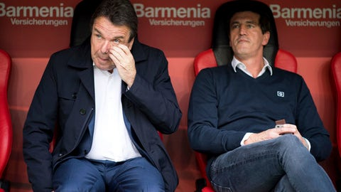 FILE - In this Sept. 24, 2017 file photo Hamburg's chairman Heribert Bruchhagen, left, and sports director Jens Todt attend the Bundesliga soccer match between Bayer Leverkusen and Hamburger SV in Leverkusen, Germany.  Relegation-threatened Hamburger SV has sacked chairman Heribert Bruchhagen and sporting director Jens Todt Thursday, March 8, 2018. (Marius Becker/dpa via AP,file)