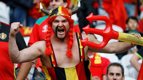 FILE - In this Friday, July 1, 2016 file photo, a Belgium fan poses for a photograph prior to the Euro 2016 quarterfinal soccer match between Wales and Belgium, at the Pierre Mauroy stadium in Villeneuve d'Ascq, near Lille, France. The Belgian football federation said on Thursday, March 8, 2018 that it will not change its mind about choosing a rapper known for lacing his songs with obscene and misogynistic lyrics to produce its official World Cup song. (AP Photo/Frank Augstein, File)