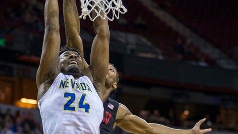 Nevada guard Elijah Cooks (4) attempts a dunk over UNLV forward Shakur Juiston (10) during the first half of an NCAA college basketball game in the quarterfinals of the Mountain West Conference tournament, Thursday, March 8, 2018, in Las Vegas. (AP Photo/L.E. Baskow)