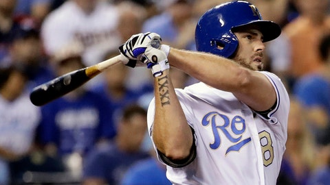 FILE - In this June 30, 2017, file photo, Kansas City Royals' Mike Moustakas hits a solo home run during the sixth inning of a baseball game against the Minnesota Twins in Kansas City, Mo. A person familiar with the negotiations tells The Associated Press that Moustakas and Kansas City have agreed to a one-year contract that keeps him with the Royals and guarantees the third baseman $6.5 million. The deal could be worth up to $22.7 million over two seasons, the person said Thursday, March 8, 2018, speaking on condition of anonymity because the agreement was subject to a successful physical. (AP Photo/Charlie Riedel, File)