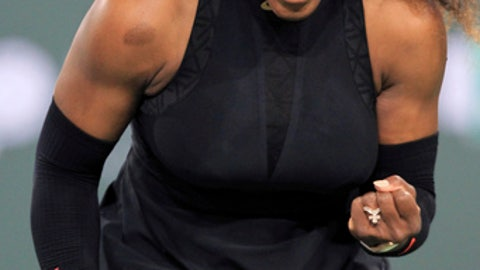 Serena Williams reacts while playing Zarina Diyas during the first round of the BNP Paribas Open tennis tournament in Indian Wells, Calif., Thursday, March 8, 2018. (AP Photo/Crystal Chatham)
