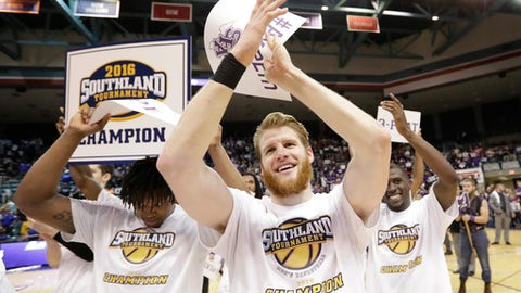 FILE - In this March 12, 2016, file photo, Stephen F. Austin's Thomas Walkup, center, celebrates with teammates after an NCAA college basketball game against Texas A&M-Corpus Christi for the Southland Conference men's tournament title in Katy, Texas. Stephen F. Austin won 82-60. Stephen F. Austin, which dominated the Southland season and received a double bye in the league tournament, made the NCAAs, beat West Virginia and nearly knocked off Notre Dame as well. (AP Photo/David J. Phillip, File)
