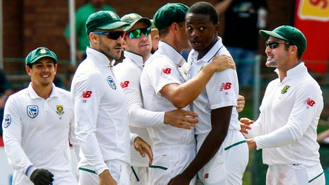 South Africa's bowler Kagiso Rabada second right with teammate celebrates after dismissing Australia's batsman Shaun Marsh for 24 runs on the first day of the second cricket test match between South Africa and Australia at St George's Pa