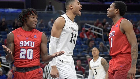 Cincinnati forward Kyle Washington (24) celebrates between SMU guard Elijah Landrum (20) and guard Jahmal McMurray (0) after scoring a basket during the first half of an NCAA college basketball quarterfinal game at the American Athletic Conference tournament Friday, March 9, 2018, in Orlando, Fla. (AP Photo/Phelan M. Ebenhack)
