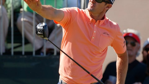 Justin Rose reacts after his drive on the 10th hole during the second round of the Valspar Championship golf tournament Friday, March 9, 2018, in Palm Harbor, Fla. (AP Photo/Mike Carlson)