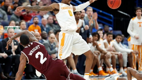 Tennessee's Jordan Bone (0) and Mississippi State's Eli Wright (2) reach for a loose ball during the second half of an NCAA college basketball game in the quarterfinals of the Southeastern Conference tournament, Friday, March 9, 2018, in St. Louis. Tennessee won 62-59. (AP Photo/Jeff Roberson)