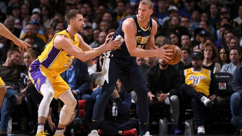 DENVER, CO - MARCH 9:  Mason Plumlee #24 of the Denver Nuggets handles the ball against the Los Angeles Lakers on March 9, 2018 at the Pepsi Center in Denver, Colorado. (Photo by Garrett Ellwood/NBAE via Getty Images)