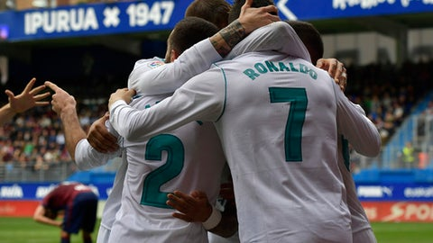 Real Madrid's Cristiano Ronaldo celebrates his second goal beside Lucas Vazquez and Daniel Carvajal after scoring during the Spanish La Liga soccer match between Real Madrid and SD Eibar at Ipurua stadium, in Eibar, northern Spain, Saturday, March10, 2018. (AP Photo/Alvaro Barrientos)