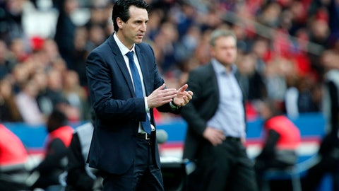PSG headcoach Unai Emery reacts after PSG's Thomas Meunier scored a goal during the French League One soccer match between Paris Saint-Germain and Metz at the Parc des Princes Stadium, in Paris, France, Saturday, March 10, 2018. (AP Photo/Thibault Camus)