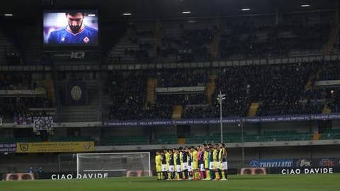 Players observe a minute of silence to honor Fiorentina captain Davide Astori, shown on a giant screen, prior to the Serie A soccer match between Hellas Verona and Chievo Verona at the Bentegodi stadium in Verona, Italy, Saturday, March 10, 2018. The 31-year-old Astori was found dead in his hotel room last Sunday after a suspected cardiac arrest. (Simone Venezia/ANSA via AP)