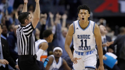 Rhode Island guard Jeff Dowtin celebrates his 3-point shot during the second half of an NCAA college basketball game against Saint Joseph's in the semifinals of the Atlantic 10 Conference tournament, Saturday, March 10, 2018, in Washington. Rhode Island won 90-87. (AP Photo/Alex Brandon)